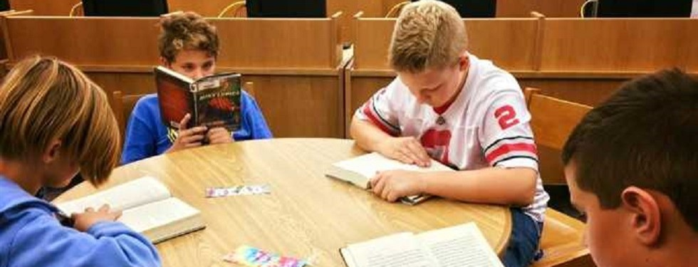 OMS students reading in the Library