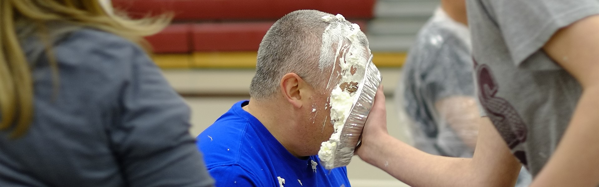 Mr. Brauch being pied in the face by a student